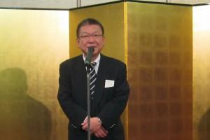 新理事長として挨拶をする田村氏